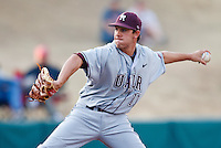 Andrew Hohn (11) winds up to pitch during the NCAA matchup between the University of Arkansas-Little Rock Trojans and the University of Oklahoma Sooners at L. Dale Mitchell Park in Norman, Oklahoma; March 11th, 2011.  Oklahoma won 11-3.  Photo by William Purnell/Four Seam Images