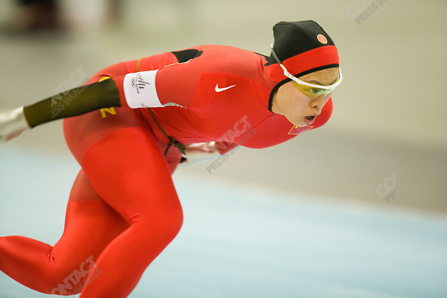 Ladies 500 M speed skating at the Oval Lingotto during the Torino Winter Olympics. Aihua Xing of CHN.