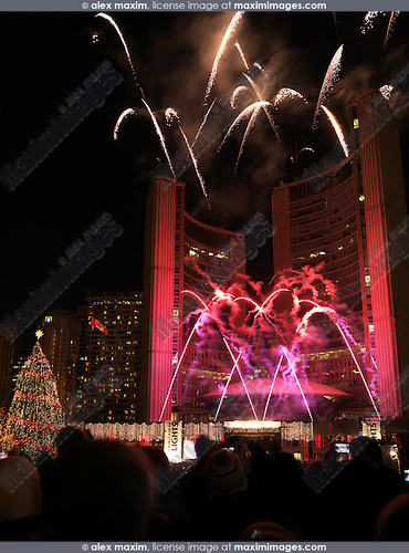 Cavalcade of Lights fireworks at Toronto City Hall Nathan Phillips Square Nov 28, 2009. Toronto, Ontario, Canada.