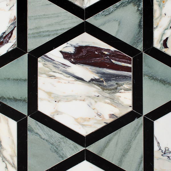 Hugo, a hand-cut stone mosaic, shown in polished Kay's Green, Nero Marquina, and Plumeria, is part of the Semplice® collection for New Ravenna.