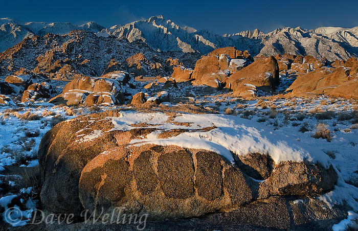 711700284 winter sunrise with snow covered granite boulders in the bureau of land management protected land the alabama hills in the southern section of the eastern sierras with lone pine peak mount whitney and mount russell in the background in kern county california