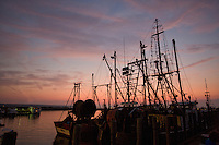 The sun sets in the fishing port of Menemsha in Chilmark, on the Massachusetts islands of Martha's Vineyard........................