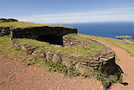 Chile, Easter Island: Orongo Village, restored archeological site where the birdman cult was practiced.  The birdman cult decided king-of-year governance by requiring athletes to bring the first egg of the season from offshore islands.  The athlete's patron became king.  The site has stone houses, petroglyphs, and a crater lake where the athletes cut reeds to make rafts to get to the island..Photo #: ch271-33722.Photo copyright Lee Foster www.fostertravel.com lee@fostertravel.com 510-549-2202