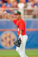June 11, 2010:     Miami Infielder Stephen Perez (4) holds the ball up for the umpire to see while trying to prove he caught the ball in the air during game one of NCAA Gainesville Super Regional action between the University of Florida Gators and Miami Hurricanes at Alfred A. McKethan Stadium on the campus of University of Florida in Gainesville.   Florida defeated Miami 7-2 to take a 1-0 lead in the best of three series............