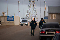 Police are seen walking outside a Bashneft oil refinery in Ufa, Bashkortostan, Russia. The area is a major oil and gas producing region in the country.