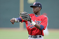 Shortstop Nick Gordon (9) of the Elizabethton Twins warms up before a game against the Johnson City Cardinals on Sunday, July 27, 2014, at Howard Johnson Field at Cardinal Park in Johnson City, Tennessee. Gordon was a first-round pick of the Minnesota Twins in the 2014 First-Year Player Draft.(Tom Priddy/Four Seam Images)