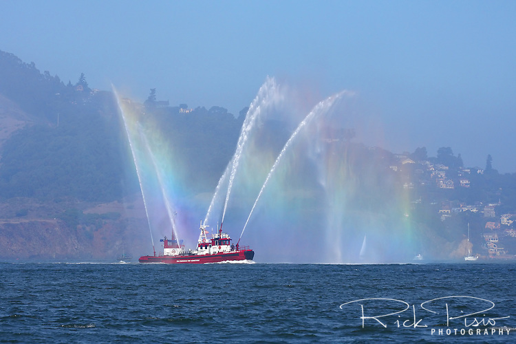 San Francisco Fire Department Fireboat Guardian creates a rainbow on San Francisco Bay.