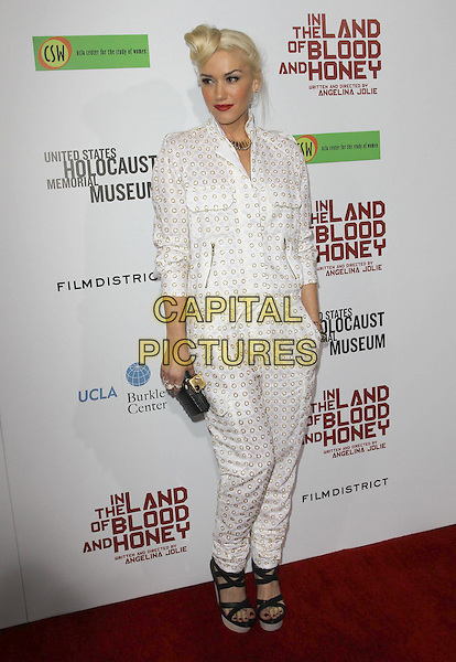 Gwen Stefani.'In The Land Of Blood And Honey' Los Angeles Premiere held at The Arclight Theatre, Hollywood, California, USA..8th December 2011.full length jumpsuit black clutch bag white gold studs studded shirt red lipstick hair up coif hair platform sandals hand in pocket .CAP/ADM/KB.©Kevan Brooks/AdMedia/Capital Pictures.