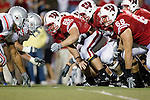 Wisconsin Badgers offensive line prepares to block during an NCAA college football game against the Ohio State Buckeyes on October 16, 2010 at Camp Randall Stadium in Madison, Wisconsin. The Badgers beat the Buckeyes 31-18. (Photo by David Stluka)