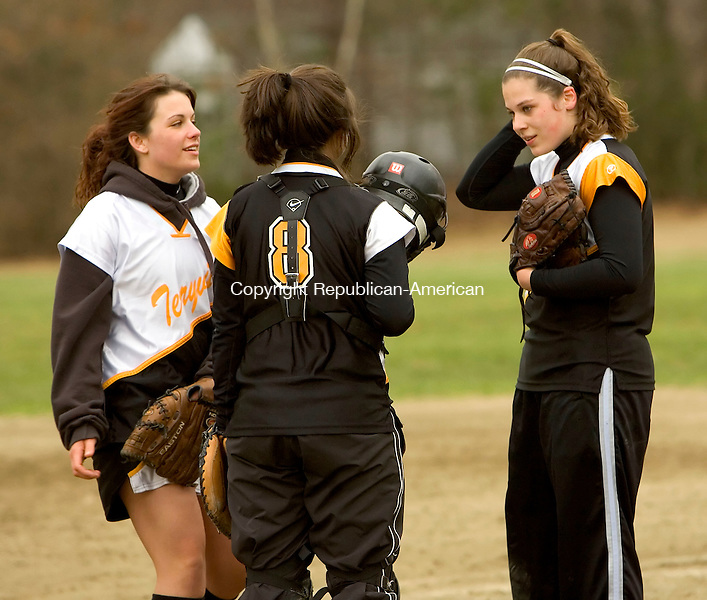 PLYMOUTH, CT--18 APRIL 2007--041807JS06-Terryville's Ashley Hogan, right, talks with third baseman Heather Luther, left and catcher Tiffany Levesque during a break in the action in their 3-1 win over Nonnewaug Wednesday at Main Street School in Plymouth.<br /> Jim Shannon / Republican-American