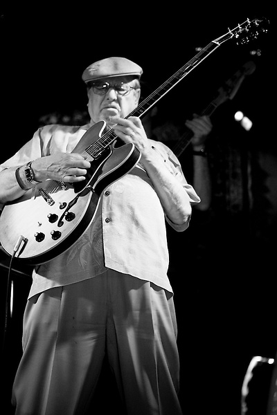 """Dennis Coffey plays his guitar at the 8th annual Ponderosa Stomp, held at the House of Blues in New Orleans on April 28, 2009. <br /> <br /> Coffey is a noted guitar player from Michigan, known for his work as a member of the """"Funk Brothers"""" studio band playing on numerous hits for Motown Records.  Coffey also recorded his own gold record selling instrumental """"Scorpio"""", which led him to perform on the television show """"Soul Train"""" in 1972, the first white musician to do so.    <br /> <br /> The Ponderosa Stomp is an annual music festival held in New Orleans since 2002 that celebrates the uncelebrated names in American musical history.  The festival spotlights musicians who have contributed to the American roots musical canon in various genres, from rockabilly to soul to rock and roll to jazz to experimental.  For two nights of the year these mostly forgotten names perform to an audience of aficionados whose memory has not faded and turn back the clock with blistering performances of the hits that did or (in the case of the regional musicians that plugged away unknown to the world at large, as well as those whose songs were recorded to acclaim by other musicians) did not make them famous.  <br /> <br /> In addition to the two nights of performances the Ponderosa Stomp Foundation (the non-profit founded by the eccentric Dr. Ira Padnos and his coterie of like minded music fanatics the Mystic Knights of the Mau Mau) also produces two days of the Music History Conference, where many of the performers, as well as other music industry names, share stories of their lives in the business.  The Conferences take place in the Louisiana State Museum at the Cabildo in Jackson Square."""
