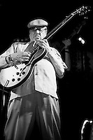 Dennis Coffey plays his guitar at the 8th annual Ponderosa Stomp, held at the House of Blues in New Orleans on April 28, 2009. <br /> <br /> Coffey is a noted guitar player from Michigan, known for his work as a member of the &quot;Funk Brothers&quot; studio band playing on numerous hits for Motown Records.  Coffey also recorded his own gold record selling instrumental &quot;Scorpio&quot;, which led him to perform on the television show &quot;Soul Train&quot; in 1972, the first white musician to do so.    <br /> <br /> The Ponderosa Stomp is an annual music festival held in New Orleans since 2002 that celebrates the uncelebrated names in American musical history.  The festival spotlights musicians who have contributed to the American roots musical canon in various genres, from rockabilly to soul to rock and roll to jazz to experimental.  For two nights of the year these mostly forgotten names perform to an audience of aficionados whose memory has not faded and turn back the clock with blistering performances of the hits that did or (in the case of the regional musicians that plugged away unknown to the world at large, as well as those whose songs were recorded to acclaim by other musicians) did not make them famous.  <br /> <br /> In addition to the two nights of performances the Ponderosa Stomp Foundation (the non-profit founded by the eccentric Dr. Ira Padnos and his coterie of like minded music fanatics the Mystic Knights of the Mau Mau) also produces two days of the Music History Conference, where many of the performers, as well as other music industry names, share stories of their lives in the business.  The Conferences take place in the Louisiana State Museum at the Cabildo in Jackson Square.