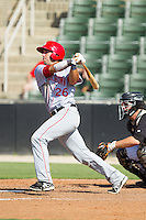 Carlos Lopez (26) of the Hagerstown Suns follows through on his swing against the Kannapolis Intimidators at CMC-Northeast Stadium on June 1, 2014 in Kannapolis, North Carolina.  The Intimidators defeated the Suns 5-1 in game one of a double-header.  (Brian Westerholt/Four Seam Images)
