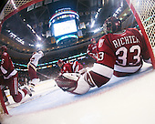 Matt Price (BC 25) heads to celebrate after Petrecki put the puck past Kyle Richter (Harvard 33). The Boston College Eagles defeated the Harvard University Crimson 6-5 in overtime on Monday, February 11, 2008, to win the 2008 Beanpot at the TD Banknorth Garden in Boston, Massachusetts.