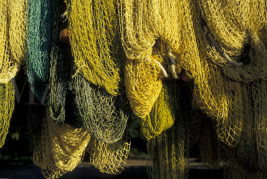 AJ2382, British Virgin Islands, fihing nets, Tortola, Caribbean, Virgin Islands, BVI, B.V.I., Yellow fishing nets hanging to dry at Brewer's Bay on the island of Tortola on the British Virgin Islands.