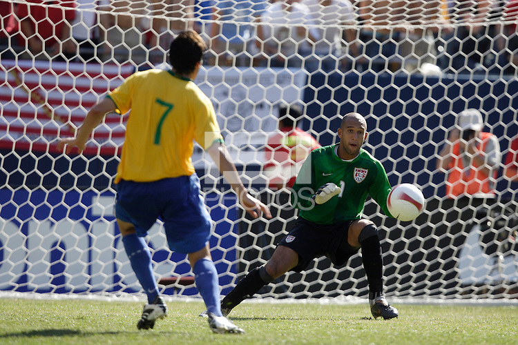 USA goalkeeper (1) Tim Howard makes a save on Brazil midfielder (7) Gilberto Silva during the first half of an international friendly between the men's national team of Brazil and the USA at Soldier Field, Chicago, IL, on September 09, 2007.