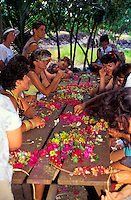 A group of women making leis at Puukohola, Big island of Hawaii