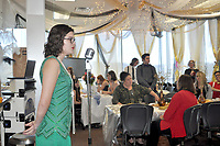 RACHEL DICKERSON/MCDONALD COUNTY PRESS Elena Josephine, dressed in a 1920s-style dress, sings during the Gateway luncheon at the McDonald County High School library on March 12, 2020. In the background, lavish decorations can be seen.