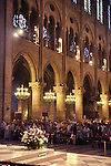 People pray at service inside Notre Dame de Paris, France
