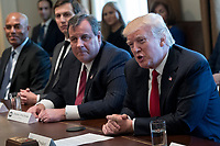 US President Donald J. Trump (R), with New Jersey Governor Chris Christie (2-R), Senior Advisor to President Trump Jared Kushner (2-L) and  former New York Yankee great Mariano Rivera (L), delivers remarks during an opioid and drug abuse listening session in the Roosevelt Room of the White House in Washington, DC, USA, 29 March 2017. Photo Credit: Shawn Thew/CNP/AdMedia