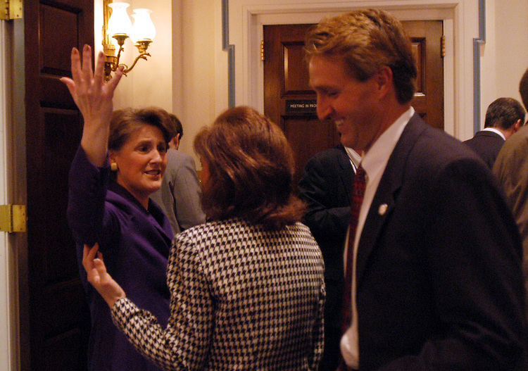 flake2/012803 - Rep. Jeff Flake (R), R-Az. and his wife, Cheryl (C), are greeted by Judy Istook, the wif eof Rep. Ernest Istook, R-ok. at a spouse meet n' greet before the State of the Union.