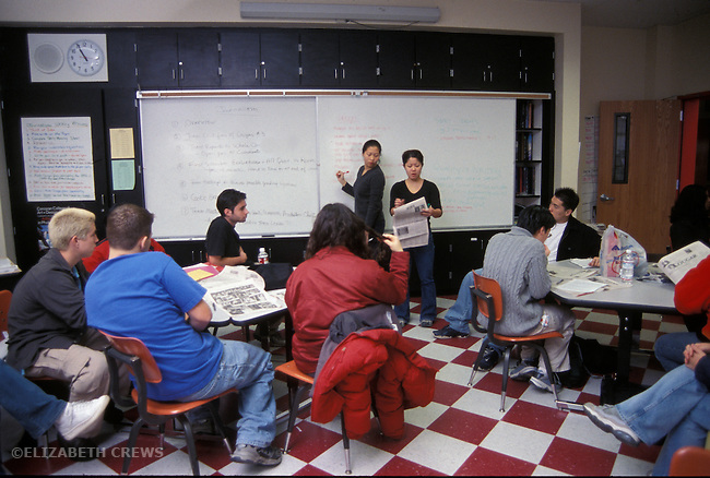 Albany CA Editor of high school newspaper going over problems with previous edition with classmates in high school journalism class