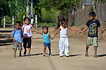 In Zapotal, Mexico, 3-year old Luz Elena Martinez (center), who is blind, walks home from preschoo with some other children. Luz attends the preschool for one hour a day in order to help prepare her to go full time the following year. On her right is her older sister, 5-year old Sandra, who will graduate from preschool the coming year, but before that she's getting Luz accustomed to the school environment to make for an easier transition.