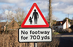 Red triangle road sign warning of no footway for 700 yards in village street, Shottisham, Suffolk, England, UK