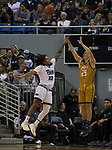 California Baptist guard Ty Rowell (25) shoots a three pointer over Nevada guard Jazz Johnson (22) in the second half of an NCAA college basketball game in Reno, Nev., Monday, Nov. 19, 2018. (AP Photo/Tom R. Smedes)