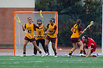 Los Angeles, CA 02/28/14 - Liz Shaeffer (USC #11), Drew Jackson (USC #14), Nina Kelty (USC #47), Alexa Wilson (USC #13) and Kirsten Viscount (Marist #22) in action during the Marist Red Foxes vs University of Southern California Trojans NCAA Women's lacrosse game at Loker Track Stadium on the USC Campus.  Marist defeated USC 12-10.