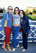 Sarajevo, Bosnia. Three fashionable young women on a bridge.