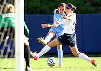 SAN DIEGO, CA - DECEMBER 02, 2012:  Alyssa Rich (00) of the University of North Carolina sends a cross past Whitney Church (17) of Penn State University during the NCAA 2012 women's college championship match, at Torero Stadium, in San Diego, CA, on Sunday, December 02 2012. Carolina won 4-1.