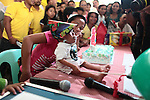 With his younger sister Giselle looking on and press photographers crushing in, the shortest man on earth, Junrey Balawing, 18, takes a bite of birthday cake in the town of Sindangan, Philippines. The Guinness World Records verified Sunday, June 12, 2011 that Balawing is the shortest man in the world. The announcement coincided with the Philippines' annual Independence Day celebration. DREW BROWN/MCT