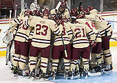 The Eagles gather around Demko. - The visiting College of the Holy Cross Crusaders defeated the Boston College Eagles 5-4 on Friday, November 29, 2013, at Kelley Rink in Conte Forum in Chestnut Hill, Massachusetts.