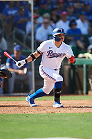 Shin-Soo Choo (17) of the Texas Rangers follows through on a swing during a Cactus League Spring Training game against the Los Angeles Dodgers on March 8, 2020 at Surprise Stadium in Surprise, Arizona. Rangers defeated the Dodgers 9-8. (Tracy Proffitt/Four Seam Images)