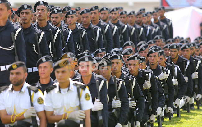 Palestinian policemen take part in a graduation ceremony, in Gaza City on July 17, 2017. Photo by Ashraf Amra