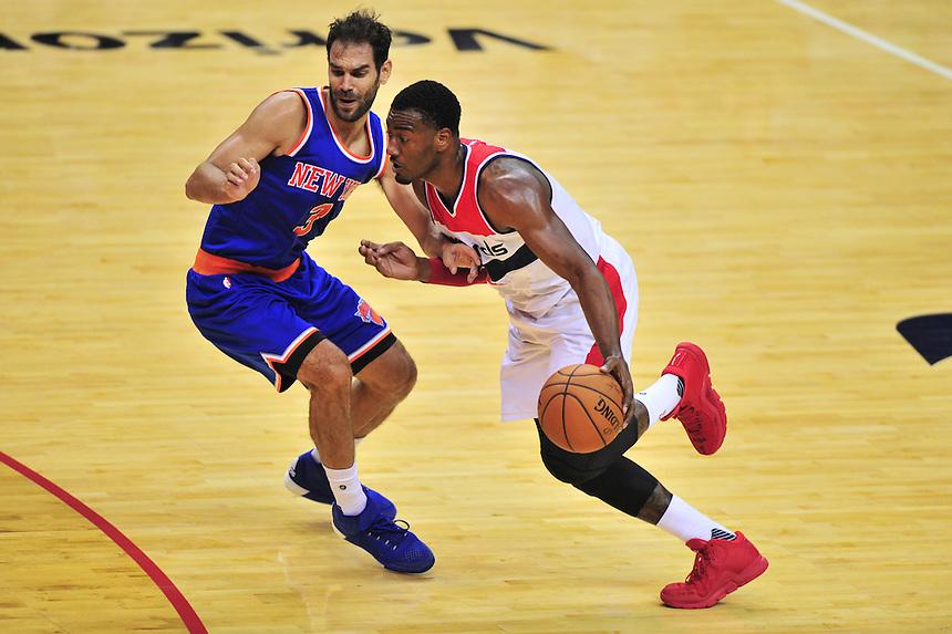 John Wall of the Wizards dribbles past Knicks' Jose Calderon. New York defeated Washington 115-104 during a NBA preseason game at the Verizon Center in Washington, D.C. on Friday, October 9, 2015.  Alan P. Santos/DC Sports Box