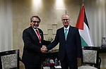 Palestinian Prime Minister Rami Hamdallah meets with a delegation from the International Federation of Red Cross and Red Crescent Societies in the West Bank city of Ramallah on December 13, 2018. Photo by Prime Minister Office