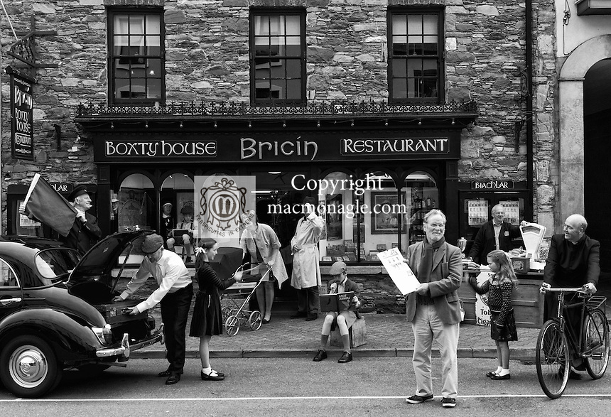 In a recreated business scene reminiscent of Killarney in the 1970's local people gather to celebrate the launch of the Killarney Calendar Past & present at Bricin Restaurant, Killarney on Monday. The calendar features the paintings of Killarney native Patrick McCarthy painted over a 20 year period and is published brothers Johnny and Paddy McGuire. Included in our picture on High Street, Killarney on Monday are from left, Michael Leahy (retired Railway Station Master), Johnny, Elizabeth, Betty, Paddy, Frank and Anna McGuire, Kate Youland, Paddy Donovan, former grocer and local curate Fr. Kevin McNamara and artist Patrick McCarthy..Picture by Don MacMonagle