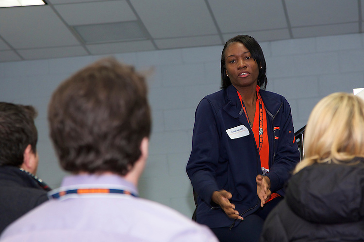 """Tanesha Wade, Director of Events and Entertainment for the Chicago Bears NFL football team, answers students' questions during a tour of game-day operations at Soldier Field to DePaul University students in the class """"Behind the Scenes with Chicago Sports Organizations,"""" Thursday, Dec. 4, 2014. The Driehaus College of Business class, taught over a single week during the winter intersession, gives students an insider's perspective on the business side of Chicago sports. (DePaul University/Jeff Carrion)"""