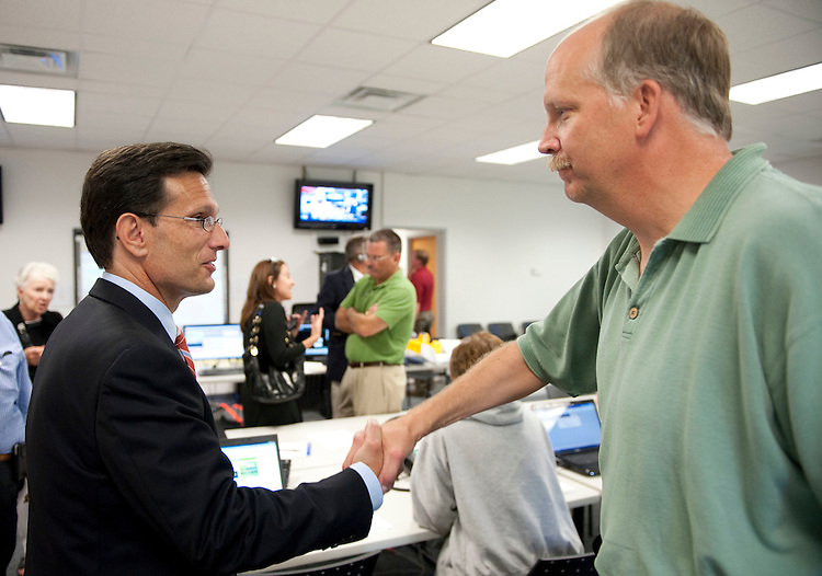 UNITED STATES - August 24 : Eric Cantor, R-VA., talks with Fritz Alderman Town of Culpeper Engineer in the local dispatch center. The damage in downtown Culpeper Virginia from the earthquake was substantial and lots of streets and businesses are closed. (Photo By Douglas Graham/Roll Call)