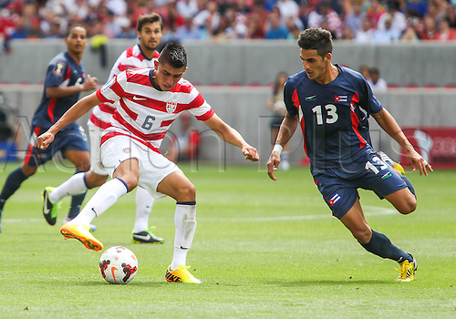 13.07.2013. Sandy, Utah, USA. US Men's National midfielder Joe Corona (6) battles with Cuba defender Jorge Luis Corrales (13)during the CONCACAF Gold Cup soccer match between USA Men's National team and Cuba at Rio Tinto Stadium in Sandy, UT. USA.
