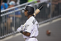 Tim Anderson (11) of the Chicago White Sox waits for his turn to bat for the Charlotte Knights on a rehab assignment during the game against the Buffalo Bisons at BB&T BallPark on July 24, 2019 in Charlotte, North Carolina. The Bisons defeated the Knights 8-4. (Brian Westerholt/Four Seam Images)