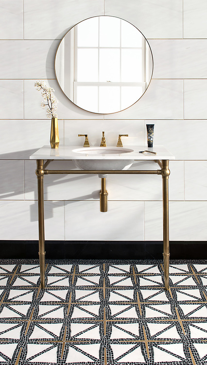 "Indus, a stone water jet mosaic, shown in tumbled Nero Marquina, honed Thassos, and brass with 12"" X 24"" polished Dolomite bricks and brass liners."
