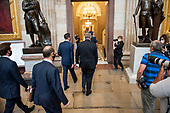 White House Chief of Staff Mark Meadows, right, and US Secretary of the Treasury Steven T. Mnuchin, left, make their way through the Rotunda for a meeting with US Postmaster General Luis DeJoy, Speaker of the US House of Representatives Nancy Pelosi (Democrat of California)., and US Senate Minority Leader Chuck Schumer (Democrat of New York), at the US Capitol in Washington, DC., Wednesday, August 5, 2020. <br /> Credit: Rod Lamkey / CNP