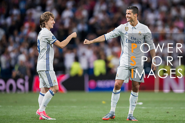 Cristiano Ronaldo (r) and Luka Modric of Real Madrid celebrate winning after their 2016-17 UEFA Champions League Quarter-finals second leg match between Real Madrid and FC Bayern Munich at the Estadio Santiago Bernabeu on 18 April 2017 in Madrid, Spain. Photo by Diego Gonzalez Souto / Power Sport Images
