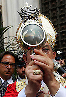 Cardinal Crescenzio Sepe, Archbishop of Naples holds a vial said to contain the blood of San Gennaro, the patron saint of Naples, during the San Gennaro miracle announcement in the cathedral of Naples, 19 September 2016