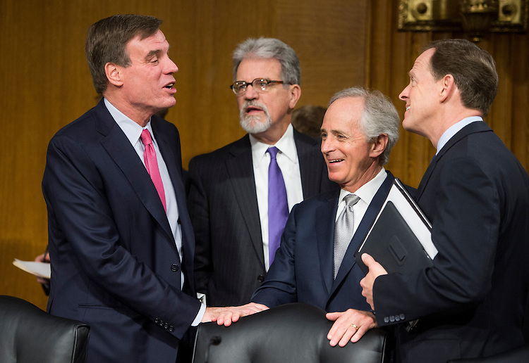 UNITED STATES - FEBRUARY 26: From left, Sen. Mark Warner, D-Va., Sen. Tom Coburn, R-Okla., Sen. Bob Corker, R-Tenn., and Sen. Pat Toomey, R-Pa., talk before the start of the Senate Banking, Housing and Urban Affairs Committee hearing with Federal Reserve Chairman Ben Bernanke on Capitol Hill on Tuesday, Feb. 26, 2013. (Photo By Bill Clark/CQ Roll Call)