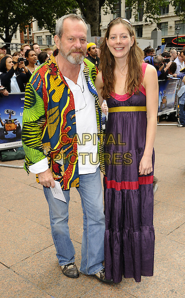 "TERRY GILLIAM & GUEST.The ""Wall-E"" UK premiere, Empire Cinema, LEicester Square, London, England..July 13th, 2008.full length jeans denim green yellow red pattern print jacket white shirt dress maxi long purple pink stripe.CAP/CAN.©Can Nguyen/Capital Pictures."