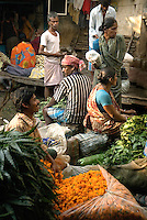 Street market in Kolkata. In India many farmers cultivate marigold flowers which are used to decorate garlands for religious ceremonies. Next to every temple and in every market, there are vendors doing good business selling these flowers.